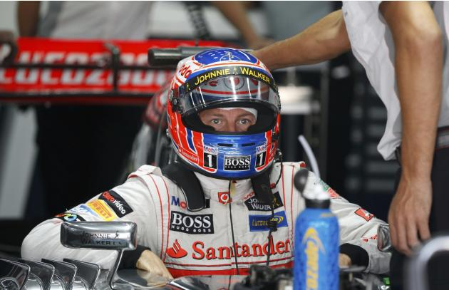 McLaren Formula One driver Button sits in his car during the second practice session of the Korean F1 Grand Prix in Yeongam