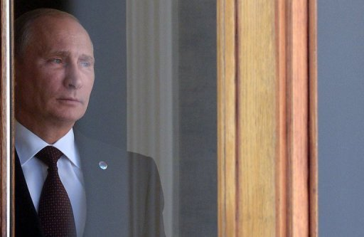 Russia?s President Vladimir Putin waits for heads of state at the start of the G20 summit on September 5, 2013 in Saint Petersburg