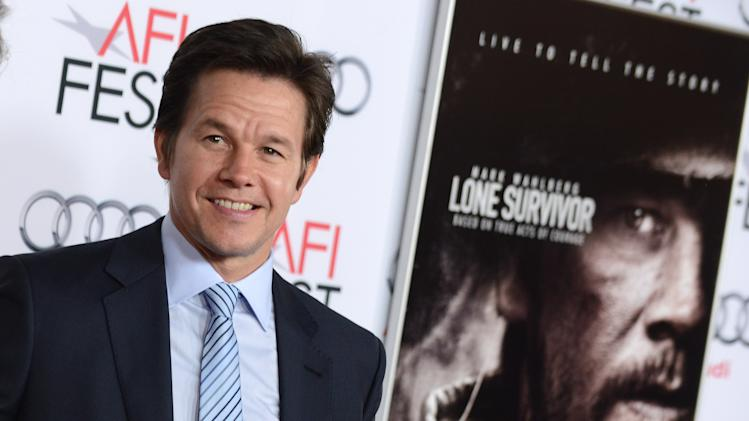 "Mark Wahlberg arrives at the 2013 AFI FEST premiere of ""Lone Survivor"" at the TCL Chinese Theatre on Tuesday, Nov. 12, 2013 in Los Angeles. (Photo by Jordan Strauss/Invision/AP)"