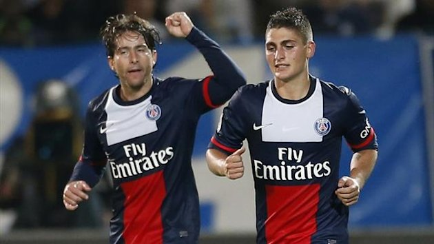 Paris Saint Germain's Maxwell (L) celebrates with team-mate Marco Verratti after scoring a goal during their French Ligue 1 soccer match against Olympique Marseille at the Velodrome stadium in Marseille October 6, 2013. (Reuters)