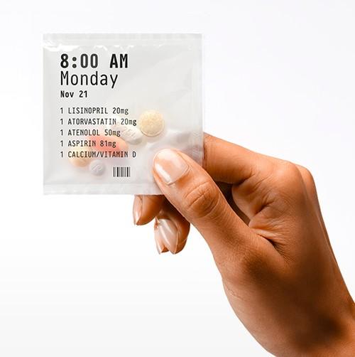 Hand holding PillPack