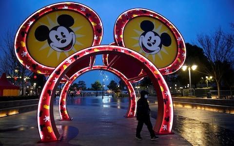 Beijing has closed many tourist attractions, such as Disneyland in Shanghai - Credit: Aly Song/Reuters