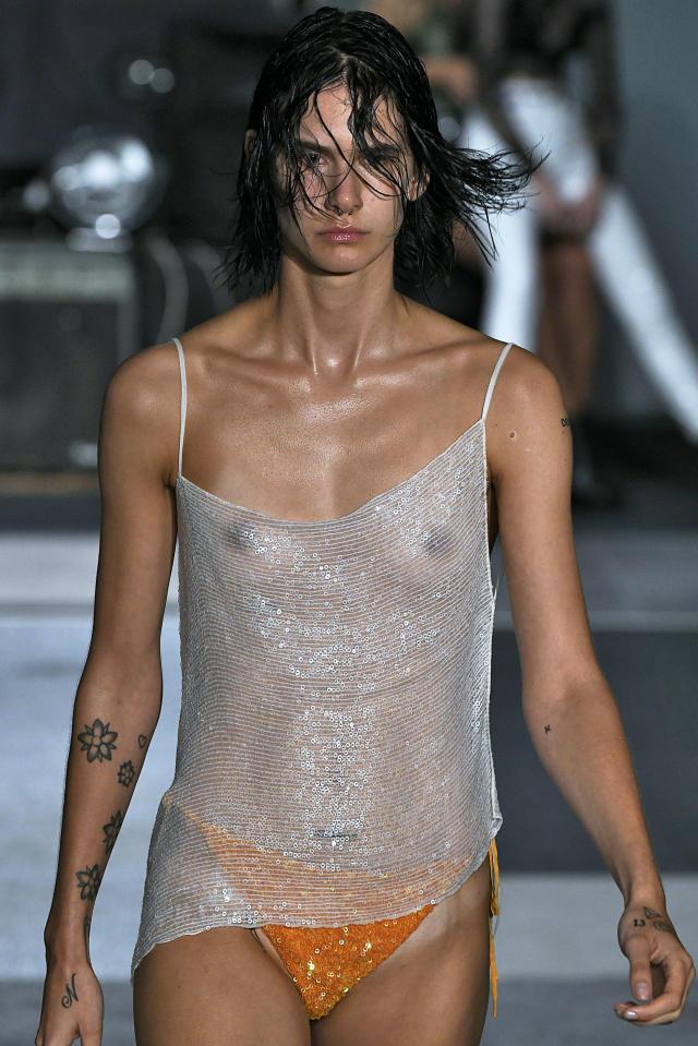 Model wearing sheer top in Ashish show