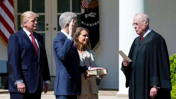 PHOTO: Supreme Court Associate Justice Anthony Kennedy administers the judicial oath to Judge Neil Gorsuch as President Donald Trump looks on during a ceremony in the Rose Garden at the White House, April 10, 2017 in Washington, D.C. (Eric Thayer/Getty Images, FILE)