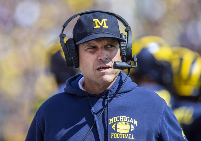 Michigan head coach Jim Harbaugh needs to go back to the drawing board after an embarrassing loss to Wisconsin on Saturday. (AP)