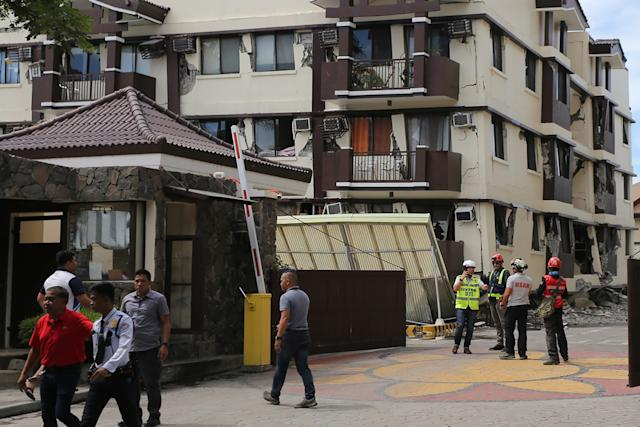 File Photo: Workers inspect a damaged condominium complex after a 6.5-magnitude earthquake hit Davao City in the southern island of Mindanao on October 31, 2019. (Photo: MANMAN DEJETO/AFP via Getty Images)