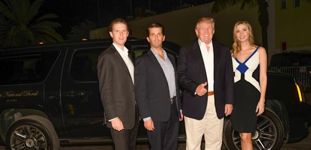 Eric Trump, Donald Trump, Jr., Donald Trump, and Ivanka Trump arrive to The Opening Drive Party at Hyde Beach on March 4, 2014 in Miami, Florida.