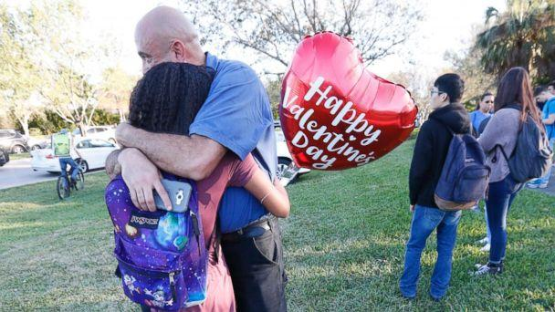 PHOTO: Family members embrace following a shooting at Marjory Stoneman Douglas High School, Feb. 14, 2018, in Parkland, Fla. (Wilfredo Lee/AP)