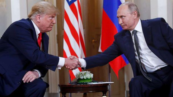 PHOTO: President Donald Trump, left, and Russian President Vladimir Putin, right, shake hands at the beginning of a meeting at the Presidential Palace in Helsinki, Finland, July 16, 2018. (Pablo Martinez Monsivais/AP, FILE)