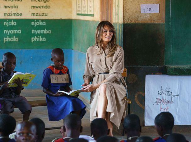 PHOTO: First lady Melania Trump helps a student as she visits a language class at Chipala Primary School, in Lilongwe, Malawi, Oct. 4, 2018. (Carolyn Kaster/AP)