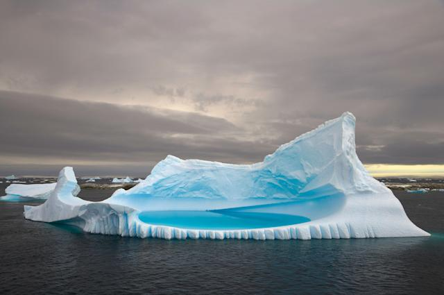 Icebergs stranded in shallow bay near Booth Island, Antarctica. (Photo: Eastcott Momatiuk/Getty Images)
