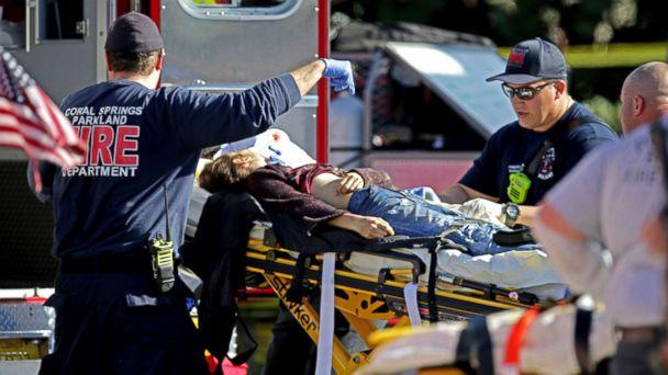 PHOTO: Medical personnel tend to a victim following a shooting at Marjory Stoneman Douglas High School in Parkland, Fla., on Feb. 14, 2018. (John McCall/South Florida Sun-Sentinel via AP)