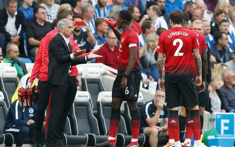 Manchester United's manager Jose Mourinho gestures as he speaks to Paul Pogba during the English Premier League soccer match between Brighton and Hove Albion and Manchester United at the Amex stadium - Credit: AP