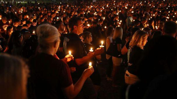PHOTO: People attend a candle light memorial service for the victims of the shooting at Marjory Stoneman Douglas High School that killed 17 people, Feb. 15, 2018, in Parkland, Fla. (Joe Raedle/Getty Images)