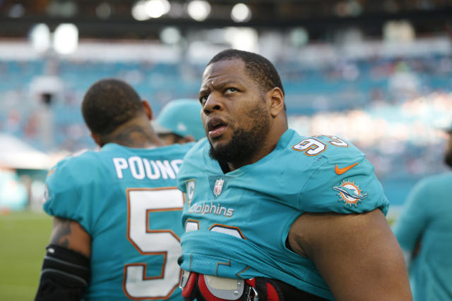 Miami Dolphins defensive tackle Ndamukong Suh described how athletes' contracts are taxed. (AP)