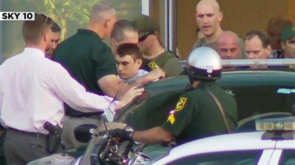 PHOTO: Nikolas Cruz, the suspect in a shooting at Marjory Stoneman Douglas High School in Parkland, Fla., is escorted out of a hospital and into a police car. (WPLG)