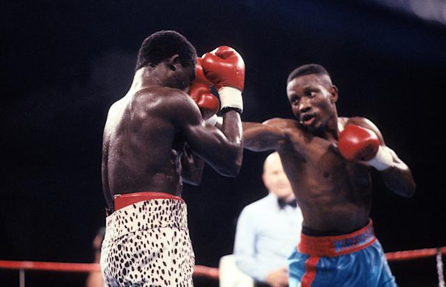 LAS VEGAS - MAY 19,1990: Pernell Whitaker (R) lands a punch against Azumah Nelson during the fight at Caesars Palace in Las Vegas, Nevada. Pernell Whitaker won the WBC lightweight title and IBF lightweight title. (Photo by: The Ring Magazine via Getty Images)