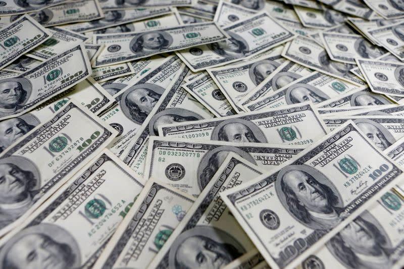 Dollar up, but yuan sluggish as traders skeptical of China PMI bounce