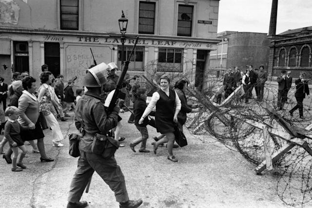 The Troubles: Heavily armed British troops patrolling a civil rights march in the Falls Road area of Belfast in 1970 (Keystone/Getty Images)