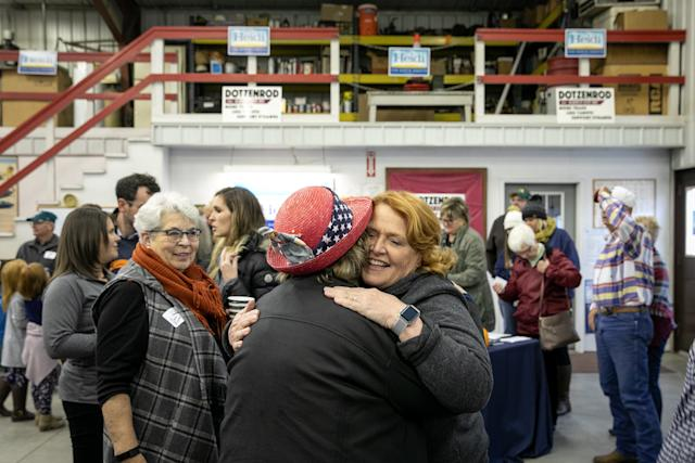 Heitkamp hugs a backer at the rally in Wyndmere. (Ilana Panich-Linsman for HuffPost)