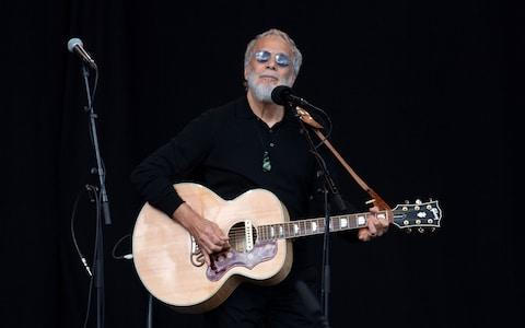 Yusuf Islam, also known as Cat Stevens, sings during a national remembrance ceremony at North Hagley Park in Christchurch - Credit: AFP