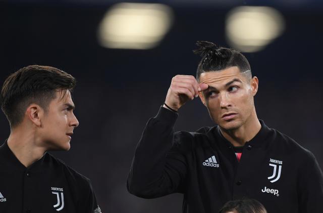 Paulo Dybala y Cristiano Ronaldo en un partido de la Juventus de esta temporada. (Foto: Alberto Lingria / Reuters).