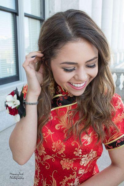 PHOTO: Keziah Daum, an 18-year-old senior at Woods Cross High School, Utah, received immediate backlash after she posted photos of her dressed in a red qipao, a traditional Chinese dress, on prom night. (Michael Techmeyer)