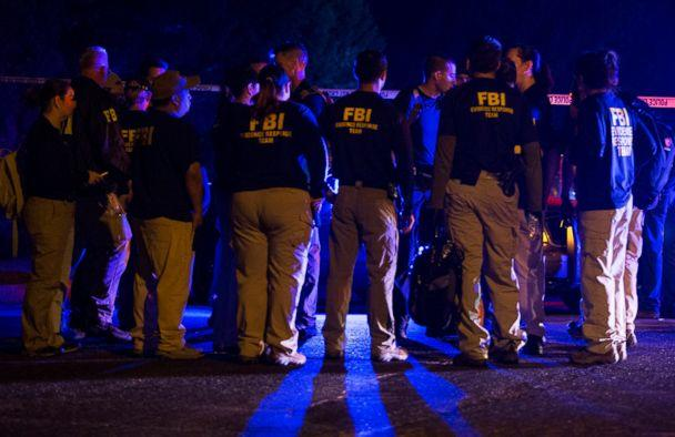 PHOTO: FBI agents meet at the scene of an explosion in Austin, Texas, Sunday, March 18, 2018. (Nick Wagner/Austin American-Statesman via AP)