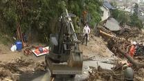 Raw: Rescue Efforts Suspended at Japan Landslide